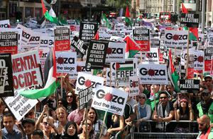 Protesters take part in a 'Stop the War' demonstration march from the Israeli Embassy to the Houses of Parliament on July 26, 2014 in London, England. (Photo by Oli Scarff/Getty Images)