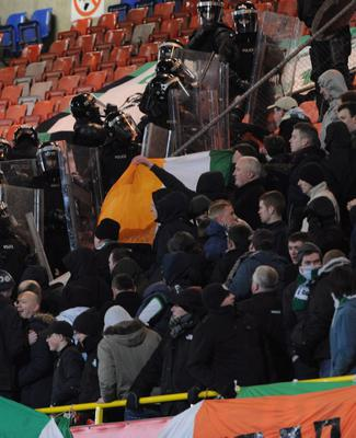 PACEMAKER BELFAST   11/3/2013 Linfield v Shamrock Rovers  Setanta Cup 1/4 final Riot police go into the Shamrock Rovers end during trouble at  this evenings game at Windsor park in Belfast. Photo Colm Lenaghan/Pacemaker Press