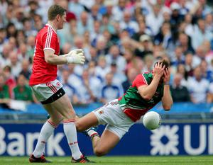 Mayo's Aidan O'Shea is fouled by Pascal McConnell of Tyrone