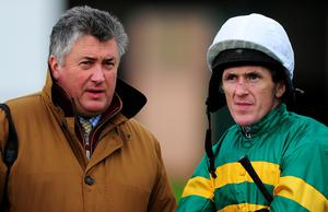 EXETER, ENGLAND - DECEMBER 18:  Trainer, Paul Nicholls looks on with AP McCoy at Exeter Racecourse on December 18, 2014 in Exeter, England.  (Photo by Dan Mullan/Getty Images)