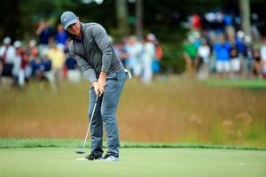 NORTON, MA - SEPTEMBER 05:  Rory McIlroy of Northern Ireland putts on the 16th green during the final round of the Deutsche Bank Championship at TPC Boston on September 5, 2016 in Norton, Massachusetts.  (Photo by Maddie Meyer/Getty Images)