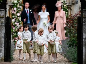 Britain's prince George (front row C), a pageboy, reacts following the wedding of his aunt Pippa Middleton (C) to her new husband James Matthews (L), at St Mark's Church in Englefield, west of London, on May 20, 2017. After turning heads at her sister Kate's wedding to Prince William, Pippa Middleton graduated from bridesmaid to bride on Saturday at a star-studded wedding in an English country church. The 33-year-old married financier James Matthews, 41, at a ceremony attended by the royal couple and tennis star Roger Federer, wearing a couture dress by British designer Giles Deacon.  / AFP PHOTO / POOL / Justin TALLISJUSTIN TALLIS/AFP/Getty Images