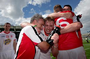 Tyrone's Matthew Mulgrew celebrates Nicky Rackard Cup success at Croke Park with manager Mattie Lennon