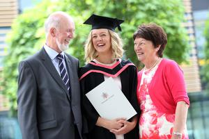 Graduating from Ulster University today with a Bdes Honour in Graphic Design is Katherine McDonald with proud parents Eamonn & Margaret. Picture John Murphy Aurora Photographic Agency.
