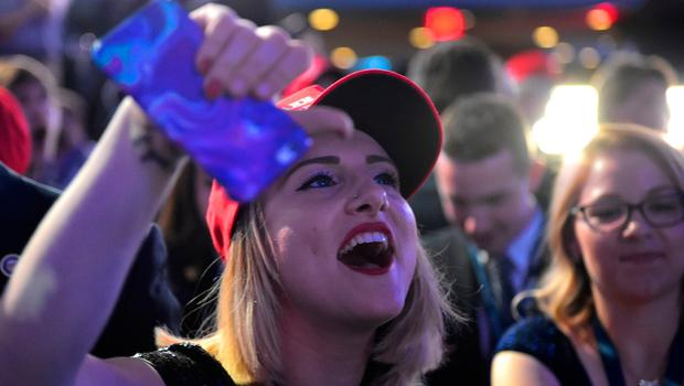 A supporter of Republican presidential nominee Donald Trump reacts to early results during election night at the New York Hilton Midtown in New York on November 8, 2016.  / AFP PHOTO / Mandel NGANMANDEL NGAN/AFP/Getty Images