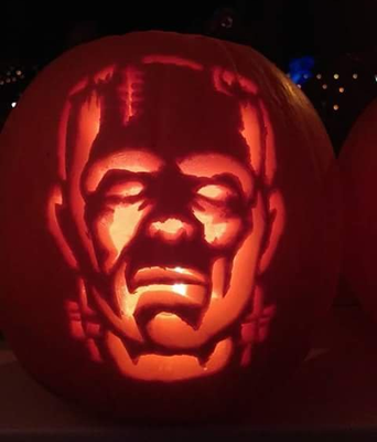 Pumpkin carved Ronan Garland from Belfast with help from daughters Eva and Aoibheann.