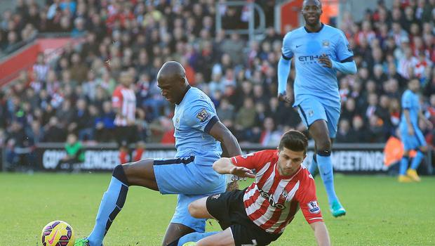 Manchester City's Eliaquim Mangala (left) fouls Southampton's Shane Long before being sent-off during the Barclays Premier League match at St Mary's Stadium, Southampton. Nick Potts/PA Wire.