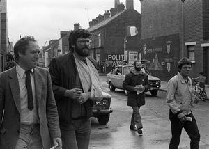 PACEMAKER PRESS INTL. BELFAST.  Danny Morrison pictured with Gerry Adams arm in sling in West Belfast canvassing for the EEC Elections. 13/6/84. 497/84/bw