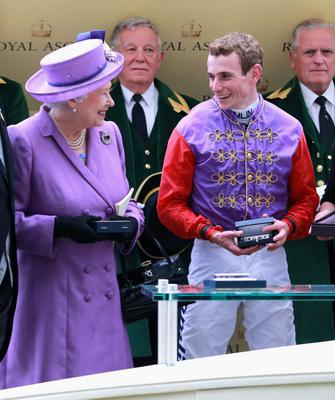 ASCOT, ENGLAND - JUNE 20:  Queen Elizabeth II with jockey Ryan Moore as they celebrate winning The Gold Cup during Ladies' Day on day three of Royal Ascot at Ascot Racecourse on June 20, 2013 in Ascot, England.  (Photo by Chris Jackson/Getty Images for Ascot Racecourse)
