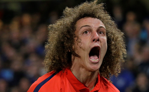 PSG's David Luiz celebrates after scoring his side's first goal during the Champions League round of 16 second leg soccer match between Chelsea and Paris Saint Germain at Stamford Bridge stadium in London, Wednesday, March 11, 2015. (AP Photo/Matt Dunham)
