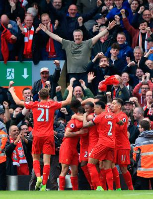 """Liverpool's Divock Origi is mobbed by his team-mates after scoring his side's third goal during the Premier League match at Anfield, Liverpool. PRESS ASSOCIATION Photo. Picture date: Saturday April 1, 2017. See PA story SOCCER Liverpool. Photo credit should read: Peter Byrne/PA Wire. RESTRICTIONS: EDITORIAL USE ONLY No use with unauthorised audio, video, data, fixture lists, club/league logos or """"live"""" services. Online in-match use limited to 75 images, no video emulation. No use in betting, games or single club/league/player publications."""