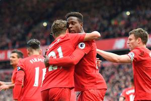 Liverpool's Belgian striker Divock Origi (2nd R) celebrates with Liverpool's Brazilian midfielder Lucas Leiva after scoring their third goal during the English Premier League football match between Liverpool and Everton at Anfield in Liverpool, north west England on April 1, 2017. / AFP PHOTO / Paul ELLIS / RESTRICTED TO EDITORIAL USE. No use with unauthorized audio, video, data, fixture lists, club/league logos or 'live' services. Online in-match use limited to 75 images, no video emulation. No use in betting, games or single club/league/player publications.  / PAUL ELLIS/AFP/Getty Images