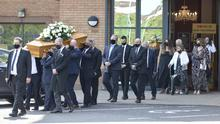 PACEMAKER, BELFAST, 21/7/2021: Margaret McConnell (in white) the wife of James McConnell, walks behind her husbands funeral cortège after a service Whitewell Church, Belfast where he was the Pastor. PICTURE BY STEPHEN DAVISON
