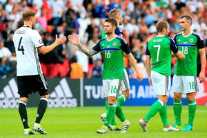 Germany's Benedikt Howedes (left) shakes has with Northern Ireland's Oliver Norwood (centre) after the final whistle during the UEFA Euro 2016, Group C match at the Parc Des Princes, Paris. PRESS ASSOCIATION Photo. Picture date: Tuesday June 21, 2016. See PA story SOCCER N Ireland. Photo credit should read: Jonathan Brady/PA Wire. RESTRICTIONS: Use subject to restrictions. Editorial use only. Book and magazine sales permitted providing not solely devoted to any one team/player/match. No commercial use. Call +44 (0)1158 447447 for further information.