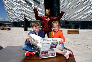 Iron Man is pictured taking Connor McKenna and Vayda Grant by surprise as he prepares to join fellow robots, cyborgs and android stars of the big and small screen, such as R2DE and T-800 from Terminator, at Titanic Belfast's ROBOTS exhibition