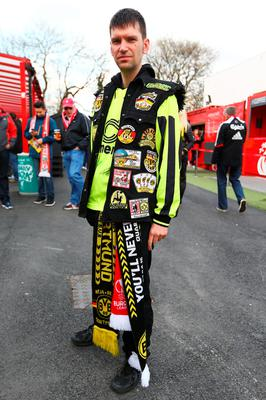 A Dortmund fan poses outside the ground prior to the UEFA Europa League quarter final, second leg match between Liverpool and Borussia Dortmund at Anfield on April 14, 2016 in Liverpool, United Kingdom.  (Photo by Clive Brunskill/Getty Images)