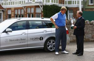 GULLANE, SCOTLAND - JULY 15:  Ernie Els of South Africa, the 2012 Open Champion talks with Peter Dawson, Chief Executive of The R&A, as Els returns the Claret Jug ahead of the 142nd Open Championship at Muirfield on July 15, 2013 in Gullane, Scotland.  (Photo by Matthew Lewis/Getty Images)