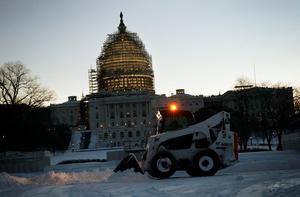 WASHINGTON, DC - JANUARY 24:  A snowplow clears snow in front of the U.S. Capitol on January 24, 2016 in Washington, DC. The blizzard that has brought massive snowfall and a standstill to the East Coast and the Mid Atlantic region has stopped.  (Photo by Alex Wong/Getty Images)