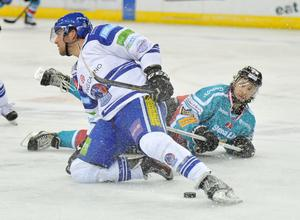 21/12/13: Kevin Saurette of the Belfast Giants in action against of the Mike Devin of the Coventry Blaze during the Elite League game at the Odyssey Arena.