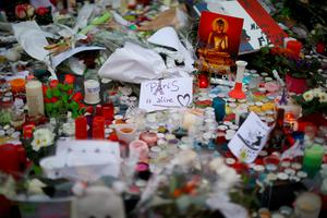 PARIS, FRANCE - NOVEMBER 16:  Flowers and tributes are left at the base of the Statue de Marianne at the Place de la Republique as a mark of respect to the victims of the Paris terror attacks last Friday, on November 16, 2015 in Paris, France. There will be a Europe-wide one-minute silence at 12pm CET today in honour of the 129 people who were killed last Friday in a series of terror attacks in the French capital. (Photo by Christopher Furlong/Getty Images)