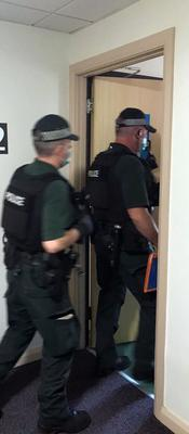Three people have been arrested in Belfast.