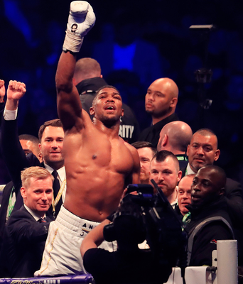 Just champion: Anthony Joshua salutes the 90,000 crowd at Wembley
