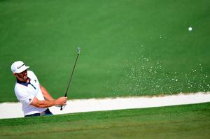 AUGUSTA, GEORGIA - APRIL 07:  Dustin Johnson of the United States plays a shot from a bunker on the second hole during the first round of the 2016 Masters Tournament at Augusta National Golf Club on April 7, 2016 in Augusta, Georgia.  (Photo by Harry How/Getty Images)