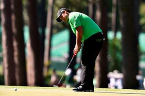 US golfer Patrick Reed putts on the 3rd green during Round 1 of the 80th Masters Golf Tournament at the Augusta National Golf Club on April 7, 2016, in Augusta, Georgia.   / AFP PHOTO / DON EMMERTDON EMMERT/AFP/Getty Images