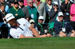 US golfer Dustin Johnson hits out of a bunker on the 2nd hole during Round 1 of the 80th Masters Golf Tournament at the Augusta National Golf Club on April 7, 2016, in Augusta, Georgia.   / AFP PHOTO / Nicholas KammNICHOLAS KAMM/AFP/Getty Images