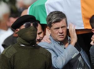 Brian Shivers carries the coffin during  the funeral of veteran IRA volunteer Tony Catney, which took place at Oliver Plunkett Church in  West Belfast on Wednesday  Pic Pacemaker