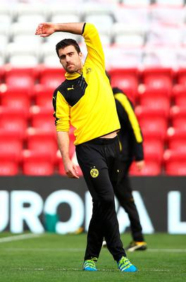 LIVERPOOL, ENGLAND - APRIL 13:  Sokratis Papastathopoulos of Borussia Dortmund stretches during a training session ahead of the UEFA Europa League quarter final between Liverpool and Borussia Dortmund at Anfield on April 13, 2016 in Liverpool, United Kingdom.  (Photo by Clive Brunskill/Getty Images)