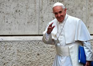 Pope Francis waves to the press as arrives for the Synod on the family at the Vatican on October 15, 2015. AFP PHOTO / ALBERTO PIZZOLIALBERTO PIZZOLI/AFP/Getty Images