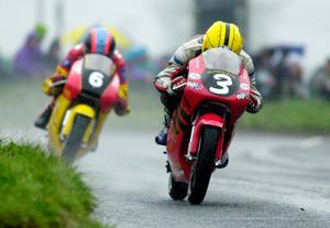 PACEMAKER, BELFAST, 29/4/2000:   Joey Dunlop leads Gary Dynes on their 125s at the Cookstown 100. PICTURE BY STEPHEN DAVISON