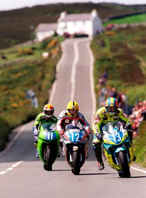 PACEMAKER BELFAST.TT 2002 was the first TT since the death of its greatest rider, Joey Dunlop (No12) seen here with Adrian Archibald at Creg Ny Baa in 1999.  Dunlop won 26 TTs before being killed in Estonia in 2000. PICTURE BY STEPHEN DAVISON