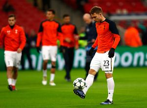 LONDON, ENGLAND - DECEMBER 07: Christian Eriksen of Tottenham Hotspur (R) warms up prior to kick off during the UEFA Champions League Group E match between Tottenham Hotspur FC and PFC CSKA Moskva at Wembley Stadium on December 7, 2016 in London, England.  (Photo by Bryn Lennon/Getty Images)