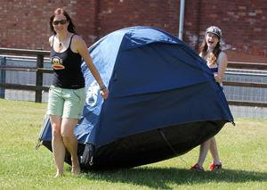 Bruce Springsteen fans move their tents into the grounds of the Kings Hall.