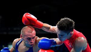 TOPSHOT - Ireland's Michael John Conlan (R) fights Russia's Vladimir Nikitin during the Men's Bantam (56kg) Quarterfinal 1 match at the Rio 2016 Olympic Games at the Riocentro - Pavilion 6 in Rio de Janeiro on August 16, 2016.   / AFP PHOTO / Yuri CORTEZYURI CORTEZ/AFP/Getty Images