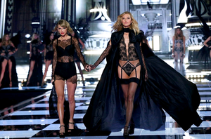 Taylor Swift and Karlie Kloss on the runway at the 2014 Victoria's Secret Runway Show  - Swarovski Crystal Looks at Earl's Court Exhibition Centre on December 2, 2014 in London, England.  (Photo by Tristan Fewings/Getty Images for Swarovski)