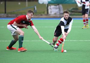 Wallace High School's Daniel McElhinney, right, in action against Friends School's Harry Scott during the Burney Cup Hockey Semi-Final.  Photo by Peter Morrison