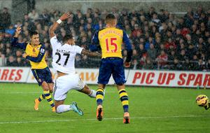 Arsenal's Alexis Sanchez scores his sides first goal of the game during the Barclays Premier League match at the Liberty Stadium, Swansea. Nick Potts/PA Wire.