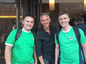 Northern Ireland fans Chris Geoghegan and Richard McKnight from Belfast bump into Gary Lineker in France.