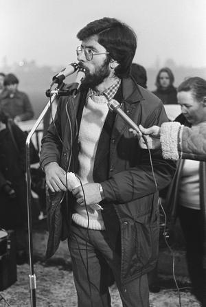 H-Block demonstration on Falls Road. From Dunville Arms  to Busy Bee. The crowd is being addressed by Sinn Fein spokesman Gerry Adams.  Pacemaker Press Intl.  30th Nov. 1980.  1032/80/BW