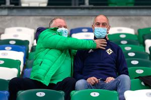 Northern Ireland fans in the stands before the UEFA Nations League Group 1, League B match at Windsor Park, Belfast. PA Photo. Picture date: Sunday October 11, 2020. 600 fans will be in attendance for the match following UEFA's decision to allow fans to return up to 30 percent of the stadium's capacity in UEFA competitions. See PA story SOCCER N Ireland. Photo credit should read: Liam McBurney/PA Wire. RESTRICTIONS: Editorial use only, No commercial use without prior permission.