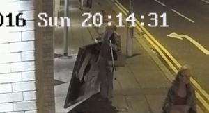 Video still of two women making off with an iconic print of Hollywood legend at the Bullitt hotel, in Belfast