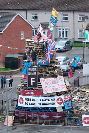 Banners are attached to a bonfire in the Bogside area of Derry in Northern Ireland to mark the Feast of the Assumption. Photo: Niall Carson/PA Wire