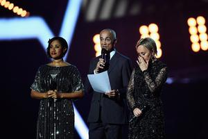Pepsi DeMacque, Andrew Ridgeley and Shirlie Holliman present a tribute to George Michael on stage at The BRIT Awards