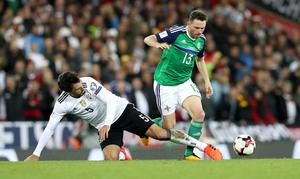 Northern Ireland's Corry Evans with Germany's Mats Hummels during Thursdays World Cup Qualifier at the National Football Stadium at Windsor Park, Belfast.   Photo by William Cherry/Presseye