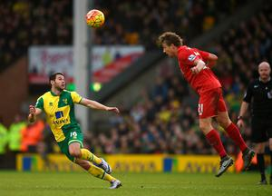 """Liverpool's Lucas Leiva (right) and Norwich City's Matthew Jarvis in action during the Barclays Premier League match at Carrow Road, Norwich. PRESS ASSOCIATION Photo. Picture date: Saturday January 23, 2016. See PA story SOCCER Norwich. Photo credit should read: Jon Buckle/PA Wire. RESTRICTIONS: EDITORIAL USE ONLY No use with unauthorised audio, video, data, fixture lists, club/league logos or """"live"""" services. Online in-match use limited to 75 images, no video emulation. No use in betting, games or single club/league/player publications."""