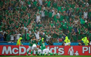 Northern Ireland's Gareth McAuley is mobbed by team-mates after scoring his side's first goal of the game during the UEFA Euro 2016, Group C match at the Parc Olympique Lyonnais, Lyon. PRESS ASSOCIATION Photo. Picture date: Thursday June 16, 2016. See PA story SOCCER N Ireland. Photo credit should read: Nick Potts/PA Wire. RESTRICTIONS: Use subject to restrictions. Editorial use only. Book and magazine sales permitted providing not solely devoted to any one team/player/match. No commercial use. Call +44 (0)1158 447447 for further information.