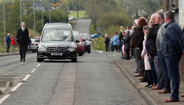 PACEMAKER,BELFAST,7/5/2020: Local people line the footpaths as the funeral cortege of former SDLP MLA John Dallat arrives at St Mary's church outside Kilrea in Co. Derry. PICTURE BY STEPHEN DAVISON